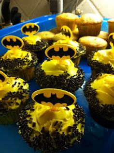 Jocy- you could do a small, elegant cake for the bridal party and batman cupcakes for the wedding guests. Might save on cost!