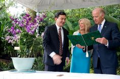 Vice President Joe Biden and Dr. Jill Biden receive a book from Dr. Nigel Paul Taylor, Director of National Parks, during a ceremony in which an orchid was named the Joe and Jill Biden Orchid, at the Singapore Botanic Gardens, in Singapore.