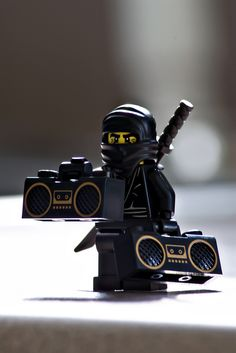 """""""The Craft Center Ninja. Shadow of the night. Blade of justice. Bringer of righteous tunes."""" Tell the ninja to keep it under on classic and don't mess with the bass. Wait make that under 4 on the volume Lego For Adults, Figure Photography, Lego Photography, Ninja Art, Lego People, Lego Minifigs, Lego Figures, Lego Worlds, Legos"""