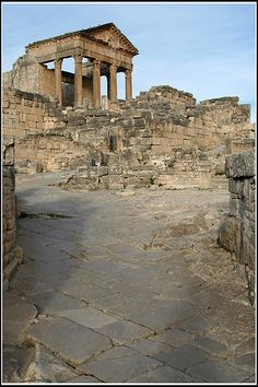 Dougga or Thugga is an ancient Roman city in northern Tunisia. Thugga's size, its well-preserved monuments and its rich Numidian-Berber, Punic, ancient Roman and Byzantine history make it exceptional. Among the most famous monuments at the site are a Punic-Libyan mausoleum, the capitol, the theatre, and the temples of Saturn and of Juno Caelestis. A UNESCO World Heritage Site