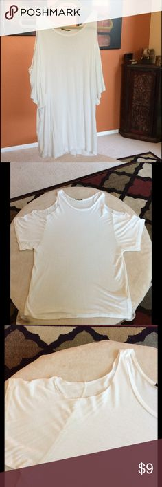 Cold Shoulder Top Off-White, or light Ivory in color, relaxed fit, cold shoulder tee. Size large. Brand is Audrey, can't remember exactly where I purchased it, will list under Nasty Gal for viewing purposes. Worn a few times. No stains or tears Nasty Gal Tops Tees - Short Sleeve