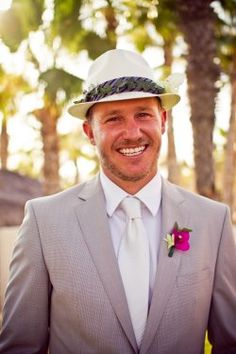 This groom is handsome in a hat made custom by adding a tropical flair for this Mexican destination wedding. Photo courtesy of Chris Ohta Photography