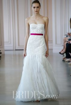 Brides.com: . Strapless corded macramé lace trumpet wedding dress with a sweetheart neckline and frayed lace and organza skirt, Oscar de la Renta