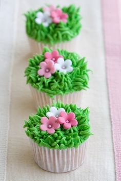 Photo about Mini cupcakes decorated with frosted grass and pink flowers. Image of baking, decorated, cupcakes - 12591477 Cupcakes Design, Cupcakes Cool, Spring Cupcakes, Easter Cupcakes, Cupcake Cookies, Mothers Day Cupcakes, Mocha Cupcakes, Buttercream Cupcakes, Velvet Cupcakes