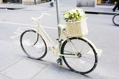 own a vintage bike with a cute wicker basket