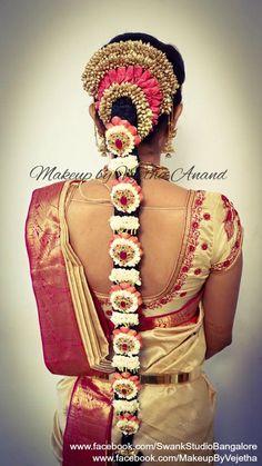 Traditional Southern Indian bride's bridal braid hair. Hairstyle by Vejetha for Swank Studio. PHOTO CREDIT: Manish Ananda. Silk Saree. Sari Blouse Design. Hair Accessories. Jhumkis. Silk Kanjeevaram sari. Braid with fresh flowers. Tamil bride. Telugu bride. Kannada bride. Hindu bride. Malayalee bride. Find us at https://www.facebook.com/SwankStudioBangalore