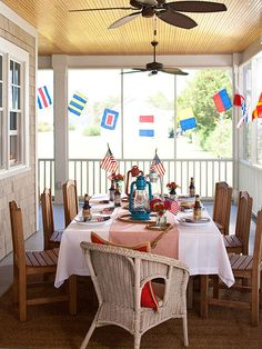 Nautical party porch with signal flags.