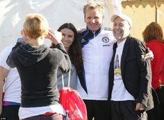 Gordon Ramsay (centre), his wife Tana and fellow chef Michel Roux Jr posed for a fan at the start of the marathon.