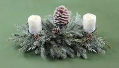 """Pack of 3 Snowy Pine & Pine Cone Christmas Pillar Candle Holder Centerpieces 28"""" by CC Christmas Decor. $99.99. Snowy Pine Pillar Christmas Candle Holder Centerpieces Item #49221Bring the outdoors in with this woodland-inspired pillar candle holder centerpieceThe mix includes realistic long needle pine, and pine conesHolds (3) 3"""" pillar candles - not includedDimensions: 28 inches longMaterial(s): metal/pine cones/man-made materialsPack includes 3 of the candle holder shown"""