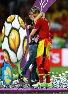 Fernando Torres Photos Photos - Fernando Torres of Spain kisses his wife Olalla Dominguez on the picth following victory in the UEFA EURO 2012 final match between Spain and Italy at the Olympic Stadium on July 1, 2012 in Kiev, Ukraine. - UEFA EURO 2012 - Matchday 19 - Pictures Of The Day