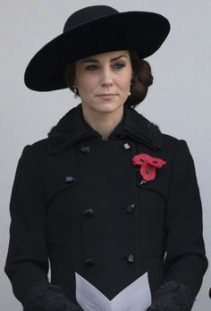 Britain's Catherine, Duchess of Cambridge, watches from a balcony the Remembrance Sunday ceremony at the Cenotaph on Whitehall, London, on November 13, 2016..Services are held annually across Commonwealth countries during Remembrance Day to commemorate servicemen and women who have fallen in the line of duty since World War I. / AFP / JUSTIN TALLIS