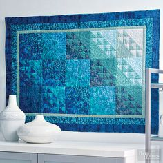 Using a range of blue and green batiks and prints gives the sense of a deep, impenetrable ocean./