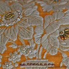 embroidered cushion detail: YUMIKO HIGUCHI