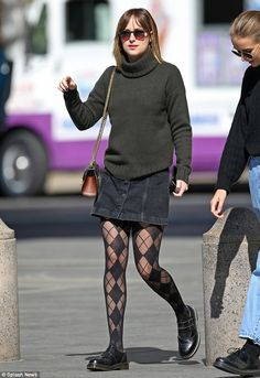 Dope duds: Dakota Johnson seemed right out of a Nineties movie when she was spotted in New...