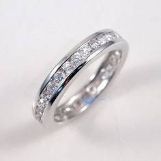 Featuring: * Store Price: $50.00 * Style: Eternity Wedding Band * Color: Silver * Stone Cut: Round * Width: 3mm, 2mm tall * Weight: 3gr * Metal: .925 Stamped Sterling Silver * Plating: 24K Gold * Elec