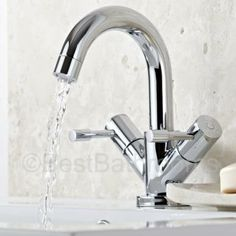 This stylish basin tap features a swivel spout and easy to use lever handles