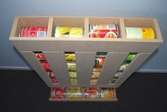 Storing food in your RV can be a hassle, especially when dealing with canned goods. Why not build your own food dispenser to keep everything organized?