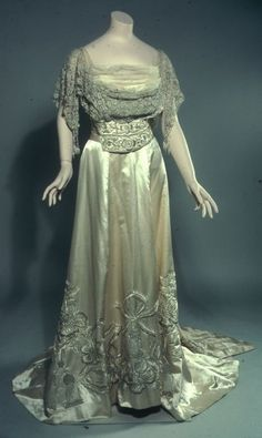Edwardian - Bodice from Evening dress (with skirt, b) Designer: Callot Soeurs Date: ca. 1906 Location: Not on display Century: 20th Century AD Media: Eggshell Satin With Silk And Silver Embroidery, Silver Lace, Tulle Department: Costume and Textile Arts
