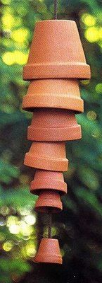 Terra cotta wind chime - Love this, but how adorable would it be with a few cans of spray paint?!