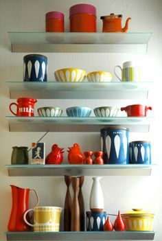 Lisa Congdon's collection of vintage colorful enamelware - Catherine Holmes - i have the red enamelware feather bowl <3 kar