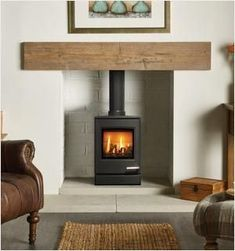 The Yeoman contemporary balanced flue gas stove features a sublte curved door and top plate making this stove ideal for modern interiors. The balanced flue kit available for this model can only be flued out of the rear flue making this gas stove pe Gas Fire Stove, Gas Stove Fireplace, Wood Burner Fireplace, Small Fireplace, Home Fireplace, Modern Fireplace, Fireplace Design, Gas Fires, Fireplace Ideas