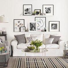 Ledge shelves with art over sofa