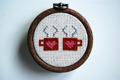 Campfire Cocoa Finished Cross-Stitch in Burnt Orange and Pink