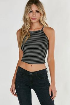 High neck sleeveless top with stripe patterns throughout. Ribbed material with straight hem all around.