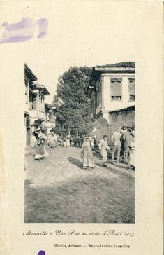 """Street """"Dimitar Vlahov"""" with view toward the """"Cinar"""" tree in August 1917. Postcard issued by Moulis France. A group of French soldiers is in the foreground, and another group behind them sightseeing."""