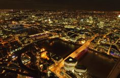 Aerial view of city and river at night London is one of the world's most frequented cities London comes with…