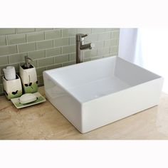 This square vitreous china sink will look great in your bathroom and is sure to impress guests. Install this sink on your countertop, and enjoy the stain- and germ-resistant vitreous china that is sure to match any contemporary bathroom setting.