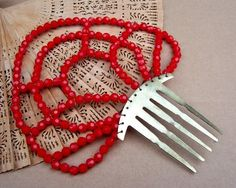 Vintage hair comb Spanish dance retro red by ElrondsEmporium, $20.00 .... this gal has the most gorgeous vintage hair accessories ♥