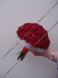 Beautiful red rose bouquet with silver wiring.