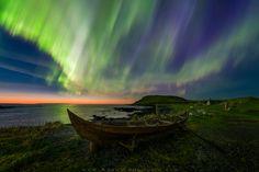 The northern lights over a rowboat in Norstead Viking Village, Newfoundland, Canada © Adam Woodworth/Aurora Photos Viking Village, Le Village, Aurora Borealis, Sky Photos, Cool Photos, Terra Nova, Earth Photos, Newfoundland And Labrador, Newfoundland Canada