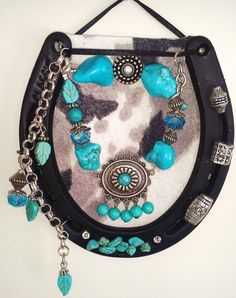 """$29.95 + Shipping  Faux Turquoise Stones Bohemian Decorated Horseshoe  Two-tone grey cow fabric background with turquoise nuggets, beads and concho pendant. Real horseshoe size 2. Charm and turquoise nugget accents. 5 1/2"""" long & 5"""" wide. Each horseshoe is original and unique.   www.thecowboysway.com"""