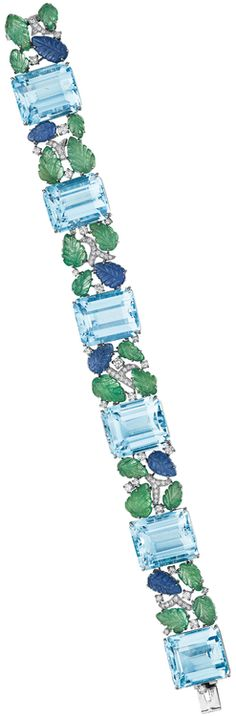 An Aquamarine, Emerald, Sapphire and Diamond Bracelet. Designed as a series of rectangular-cut aquamarines, weighing approximately 122.15 carats in total, interspersed with carved sapphire and emerald leaves, enhanced by circular-cut diamonds, mounted in 18K white gold, length 8 inches. Via Phillips.