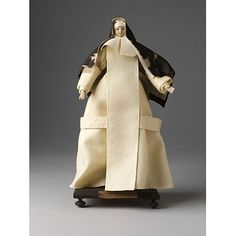 Carthusian Nun    Object:  Ecclesiastical figure    Place of origin:  France (possibly, made)   germany (possibly, made)   Netherlands (possibly, made)    Date:  18th century (made)    Artist/Maker:  Unknown (production)    Materials and Techniques:  Figure made of tow and wax, dressed in linen and woollen materials.    Credit Line:  Given by Mr. G. Smith    Museum number:  1212:48-1905    Gallery location:  In Storage