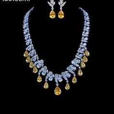 @sharm_jewell. Fancy Yellow Diamonds and White diamonds Necklace and matching Earrings