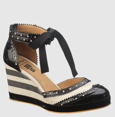 Anna Sui's spectator wedge for Hush Puppies.