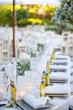 Provençal party - the elements can be easily convertible to a Puerto Rico theme - mini bottles of rum, flamboyan flowers in the vases, napkins in tropical colors!