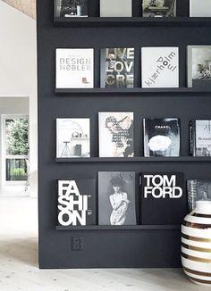 love the black shelves on a black wall