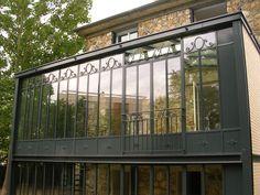 Photo : véranda à deux étages de style atelier d'artiste