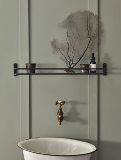 """Another Bilton Bathroom Shelf, this one in blackened bronze. With a simple glass inset, it """"offers a platform to display the more beautiful of your unguents and lotions, rather than tucking them away in cupboards."""""""