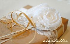 brown paper, lace, raffia, ribbon and a crepe paper peony!