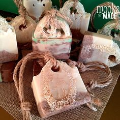 Each of these soaps is a loofah surrounded by handmade soap. The soap is made from skin loving oils and is perfect for an outdoor beach shower. The loofah and walnut shells will scrub away the beach sand and the peppermint essential oil has a cooling sensation which is perfect after a hot day in the sun. Soaps are tied with natural jute - perfect for hanging in your shower. This soap comes in a choice of Peppermint or Coconut Key Lime. Soaps weigh approximately 3 ounces. Weights, shapes and…