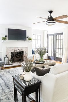 A modern meets traditional meets farmhouse summer living room with ideas for decorating a light, airy space using budget solutions.  #summerdecor #livingroom