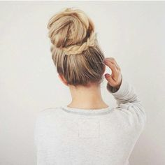 Blonde Braided long hair wrapped updo hairstyle. Prom hairstyle