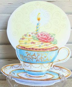 """Carol Wilson Birthday Card Cupcake with Candle in Tea Cup, Glitter by Carol Wilson Fine Arts, Inc.. $3.99. Beautifully embossed 5"""" x 7"""" greeting card with envelope."""