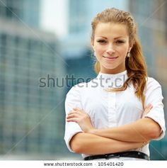 stock-photo-portrait-of-young-business-woman-on-building-background-105401420.jpg 450×452 pixels