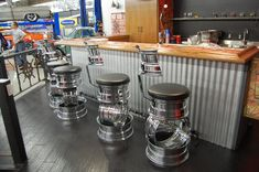 I'd love to have this in my garage! Bar stools made from rims, camshaft footrest and Hurst shifter tap handle.